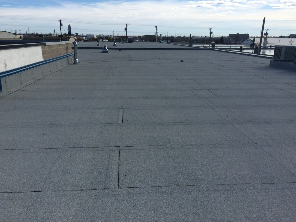 old tar and gravel roof replacement in Edmonton and surrounding areas