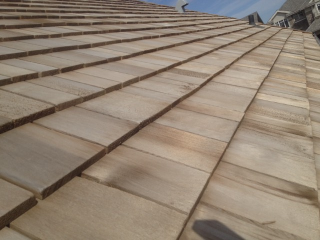A completed shingle roofing project